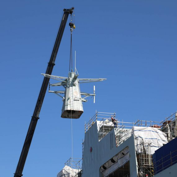Installing the Forward Mast onto the future HMCS Margaret Brooke, the second Arctic and Offshore Patrol Ship under construction at Halifax Shipyard.