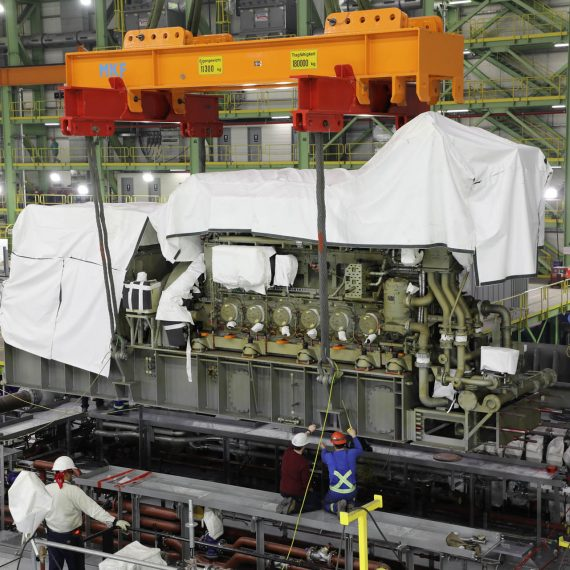 The aft engines of Ship 3, the future HMCS Max Bernays, are mounted in place on the ship's centre mega-block.